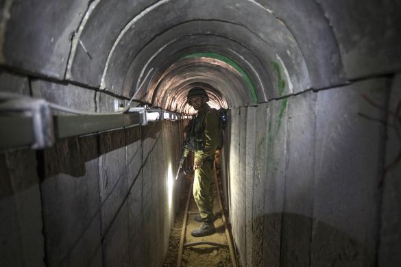 Israeli army officer walks during an army organised tour in a tunnel said to be used by Palestinian militants for cross-border attacks